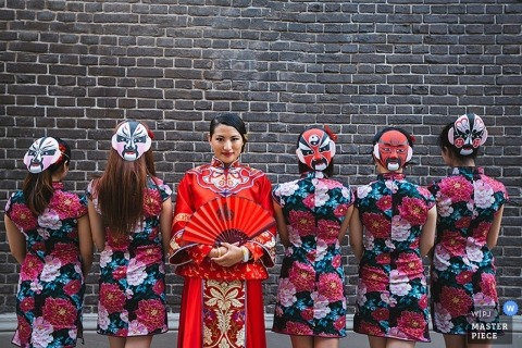 Tianjin Wedding Photographer | Image contains: fan, bridesmaids, bride, portrait, brick wall