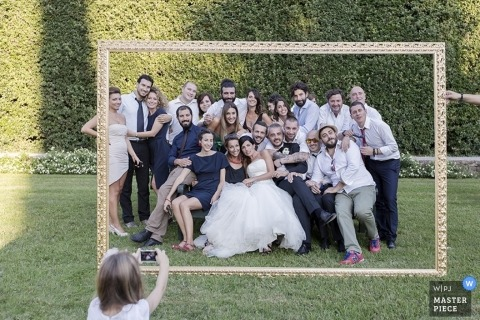 Pistoia Wedding Photos | Image contains: bride, groom, bridal party, wedding guests, frame, outdoors, photos