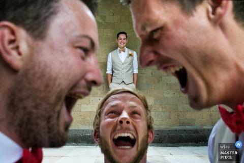 Bali Wedding Photographer | Image contains: groomsmen, laughing, friends, closeup
