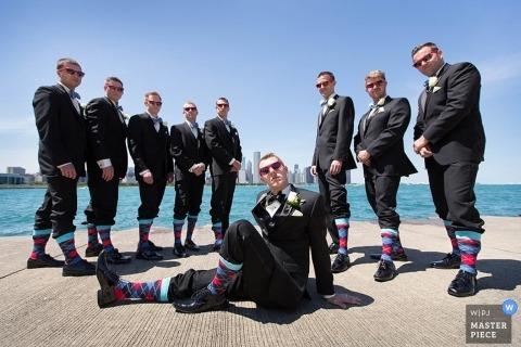 Chicago Wedding Portraits | Image contains: groomsmen, water, socks, posing, sunglasses