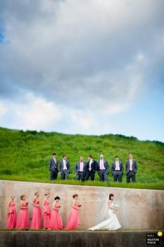 Denver Wedding Photographer | Image contains: groomsmen, bridesmaids, bride, pink dresses, bouquets, grass, sunny day