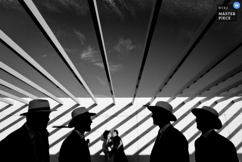 Landes Wedding Photographer | Image contains: black and white, cowboy hats, couple, groomsmen, outdoors, sunlight