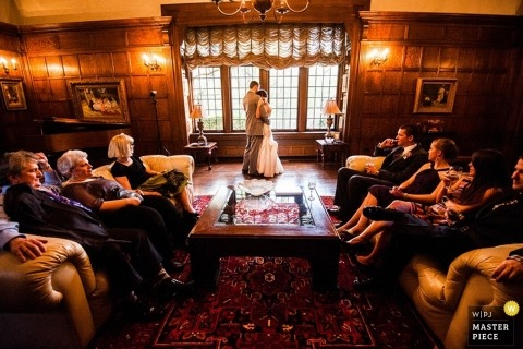 Cleveland Wedding Photojournalism | Image contains: bride, groom, wedding guests, ceremony, windows