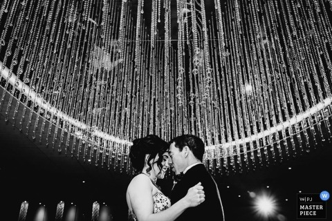Montreal Wedding Photography | Image contains: black and white, bride, groom, portrait, dancing, wedding reception, crystals, party