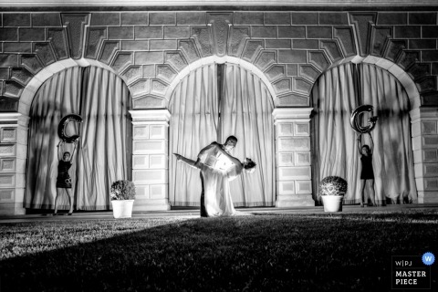 Florence Wedding Photographer | Image contains: nighttime, black and white, lights, bride and groom, letters, pose