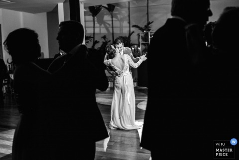 Sao Paulo Wedding Photographer | Image contains: dance floor, silhouette, bride and groom, first dance, black and white, reception