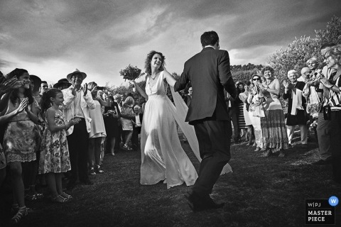 Paris Wedding Photography | Image contains: dancing, outdoors, bride and groom, black and white, flowers, ceremony