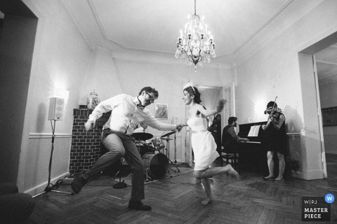 Lower Saxony Germany award winning wedding photographer - bride and groom image - dancing in black and white.