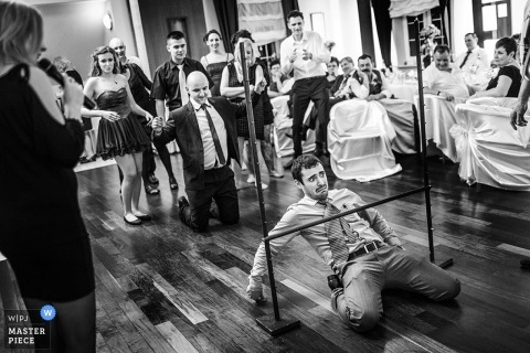 Lower Silesian Creative Wedding Photographer for Poland | Image contains: black and white, wedding guests, limbo, wedding reception, party, tables, chairs