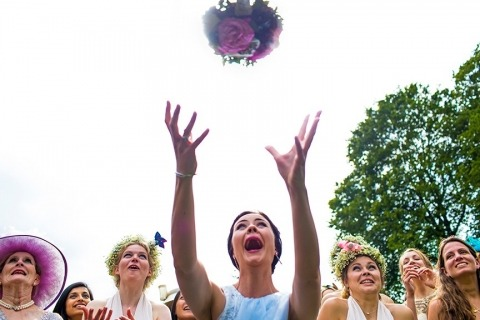 Wedding boquet toss and catch by Reportage Photographer David Pullum of United Kingdom