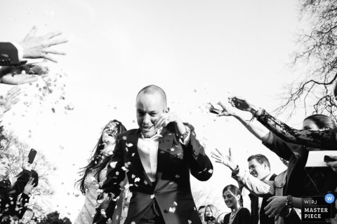 Dorset Wedding Reportage | Image contains: black and white, bride, groom, confetti, ceremony, wedding guests