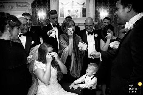 Devon Documentary Wedding Reportage| Image contains:black and white, bride, groom, wedding reception, emotional
