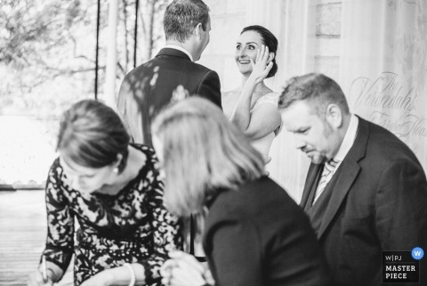 New South Wales Wedding Photojournalism | Image contains:black and white, bride, groom, reception, wedding guests, ring
