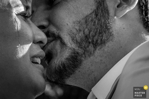 Lyon Wedding Photographer | Image contains: black and white, groom, bride, portrait, kissing, close up