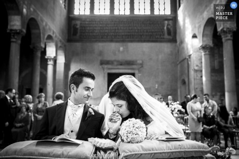 Rome Wedding Photographer | Image contains: black and white, bride, groom, church, wedding ceremony, flowers, bouquet