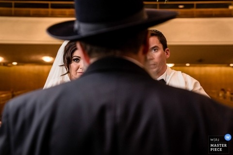 Montreal Creative Wedding Photographer | Image contains: wedding ceremony, bride, groom, church, pastor, vows