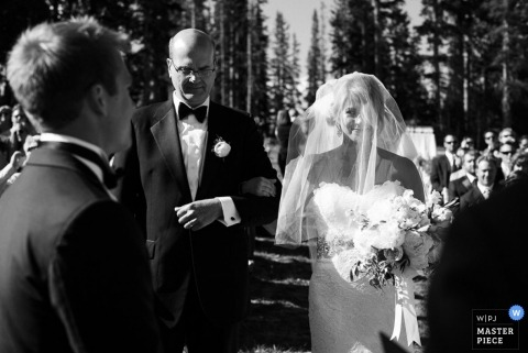 Vail Wedding Photographer | Image contains: bride, groom, ceremony, outdoors, black and white, veil, portrait, bouquet, father of the bride, wedding guests
