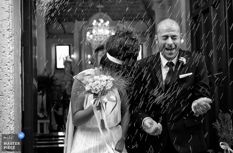 Lecce Wedding Photographer | Image contains:black and white, rice, bouquet, leaving the ceremony, portrait, bride, groom, outdoors