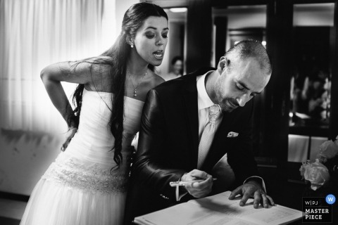 Porto Portugal wedding photography | bride groom signing marriage certificate black white