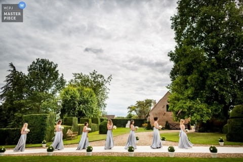 Hertfordshire Wedding Reportage Photographer | Image contains: bridesmaids, outdoors, trees, clouds, dresses, bouquets