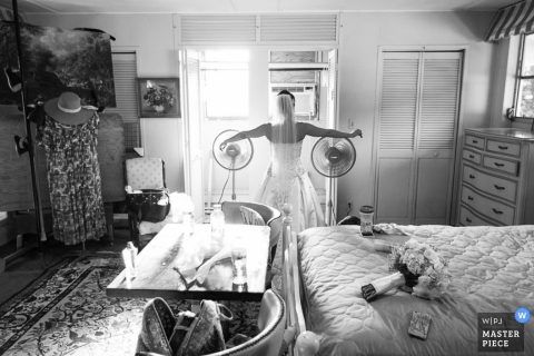 Madison Documentary Wedding Photography | Image contains: bride, black and white, dress, getting ready, bouquet, flowers