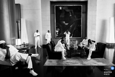 Madison Documentary Wedding Photographer | Image contains: black and white, groom, groomsmen, getting ready