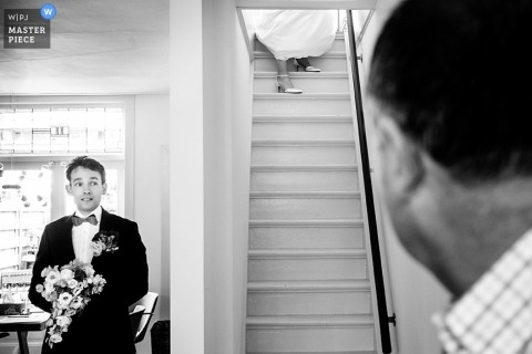 Utah Wedding Photographer | Image contains:black and white, groom, flowers, bouquet, bride, staircase