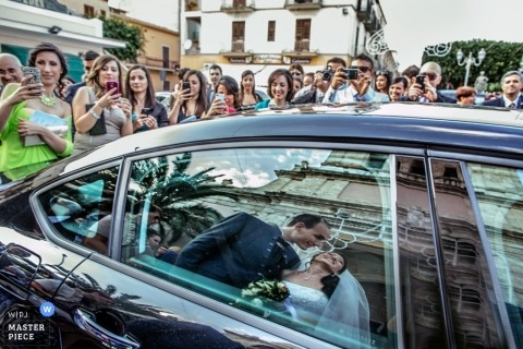 Messina Wedding Photographer | Image contains: guests, cameras, car, reflection, bride and groom, ceremony