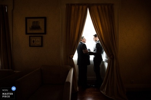 Libson Artistic Wedding Photography   Image contains: portrait, groom, father, window, curtains, suit, getting ready