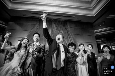 Singapore Wedding Photographer | Image contains: black and white, groom, bride,  wedding guests, celebrating