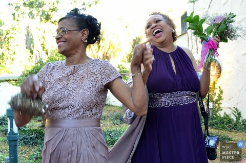 Phoenix Wedding Photography | Image contains: bridesmaids, flowers, laughter, outdoors, bouquet