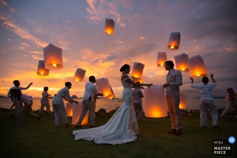 Bangkok Documentary Wedding Photography | Image contains: bride, groom, sunset, paper lanterns, wedding guests