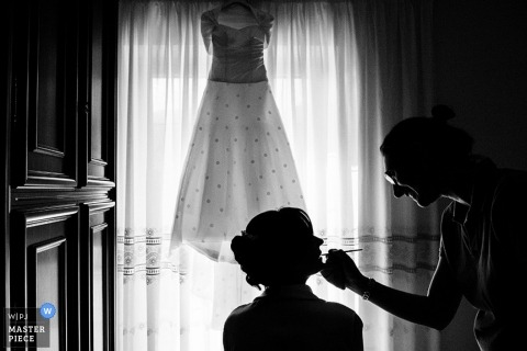 Rome Documentary Wedding Photographer | Image contains: black and white, silhouette, getting ready, wedding dress, bride