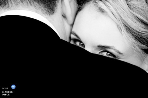 Sydney wedding photographer creates an image of the brides eyes as she looks over the grooms shoulder