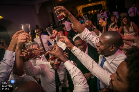 Lisbon wedding photographer shoots the action in this rowdy toast at the reception