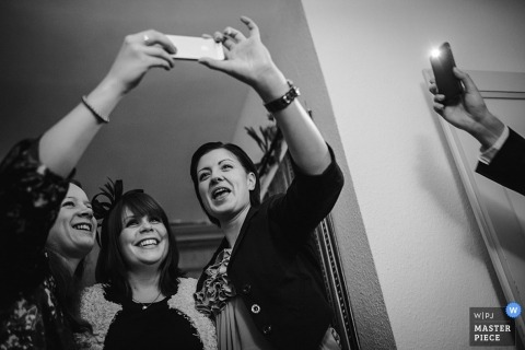 Baden-Wurttemberg wedding photographer created this black and white image of a group of wedding guests taking a selfie