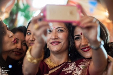 Montana wedding photographer got this shot of the bride and guests taking selfies at the reception