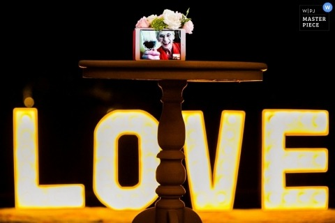 Bali wedding photographer captured this image of a wedding guests who could not attend watching the wedding from a video chat on her phone
