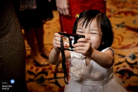San Francisco wedding photographer gets a shot of a little girl taking selfies with a camera