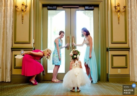 Key West wedding photographer caught the moment the flower girl was getting a pep talk before making her debut at the wedding