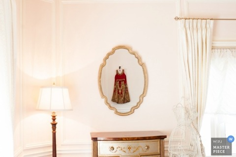 Denver wedding photographer created this photo of the reflection of the brides dress in a mirror