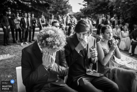 Turin wedding photographer creates a black and white emotional image of wedding guests wiping tears at the wedding ceremony