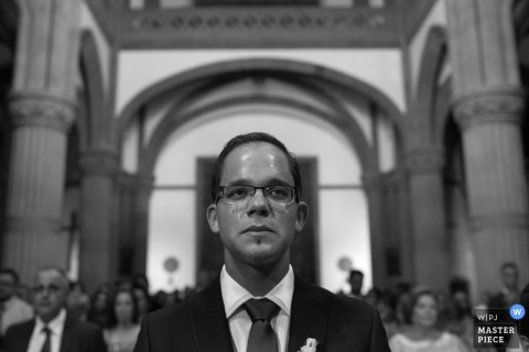 Madrid wedding photographer captured this beautiful black and white grooms portrait as he tries to keep from crying while entering the ceremony