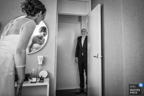 Overijssel wedding photographer captured this black and white photo of the brides father seeing her in her dress for the first time before the ceremony