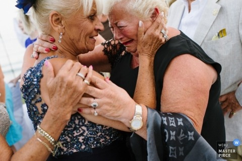 Malaga wedding photographer caught the moment that the mothers of the bride and groom shared an emotional embrace