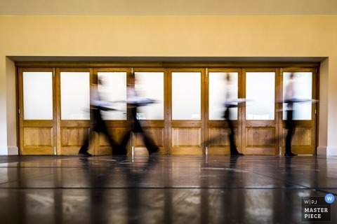 Hertfordshire wedding photographer created this artistic photograph of the food vendors walking to the tables