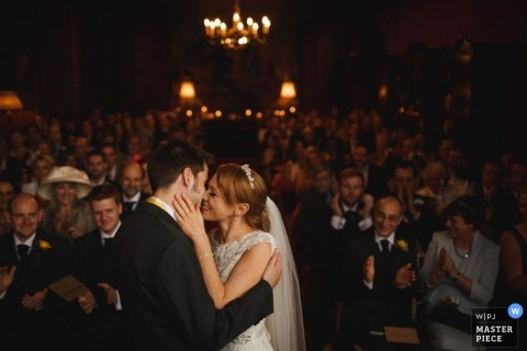Chesire wedding photographer seized the moment in this image of the bride and grooms first kiss at their wedding ceremony