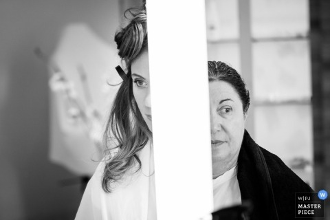 Nantes wedding photographer captured this black and white photo of the bride getting ready for the wedding while her mother stands by