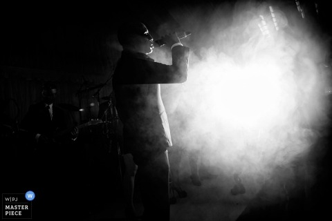 Devon wedding photographer captured this black and white photo of the wedding band playing in a cloud of fog at the reception