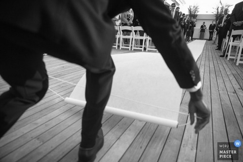 Bronx wedding photographer designed this black and white image of the aisle runner being laid out before the ceremony